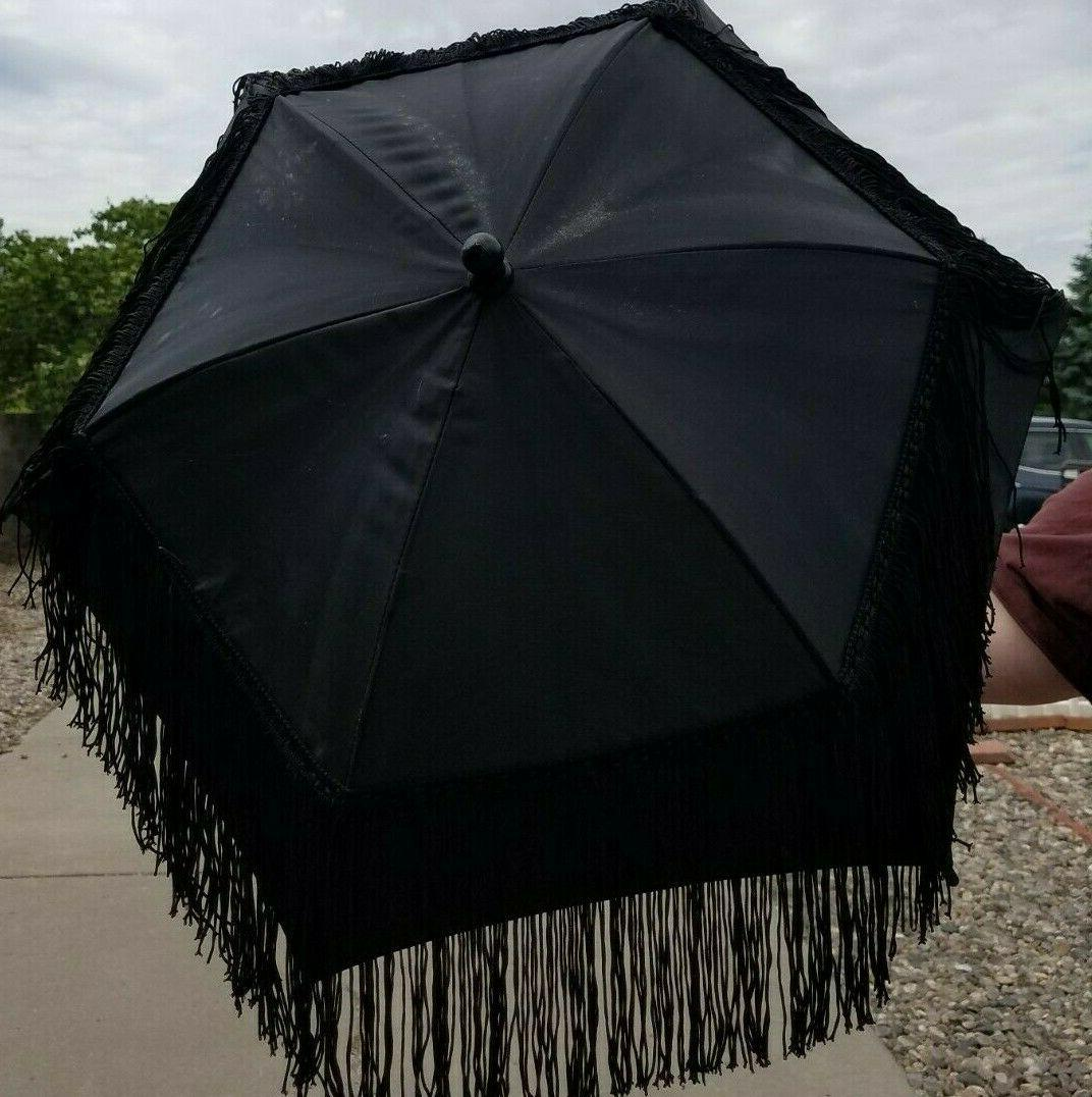 decorated nylon parasol with painted wood handle