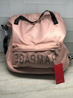 pink backpack with handle and adjustable straps